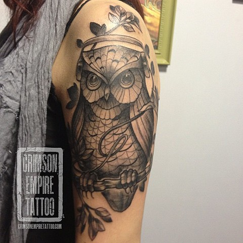 Owl on arm by Chad Clothier