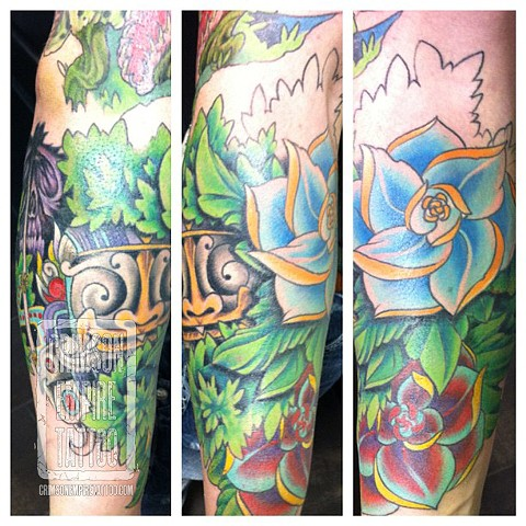 Flowers and green mask on forearm by Jared Phair. Follow Jared @jroctizzle