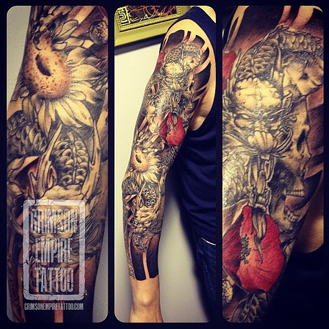 Flower and dragon sleeve on arm by Chad Clothier
