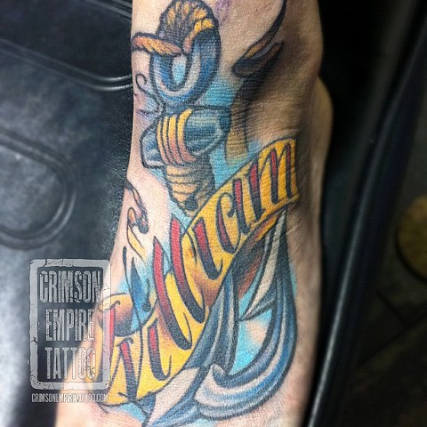 Anchor and script on foot by Jared Phair