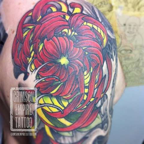 Red Yellow Flower on Bicep by Jared Phair