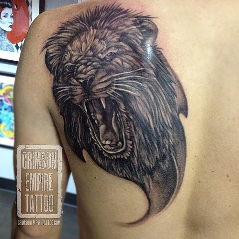 Lion on back and shoulder by Josh Lamoreux. Follow Josh @joshlamoureux