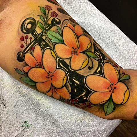 Colour Anchor and Flower Upper Arm Tattoo
