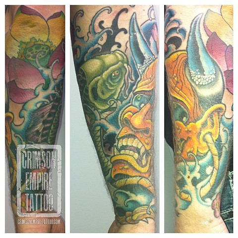 Mask and koi sleeve on forearm by Curt Semeniuk. Follow Curt @ol_curty_bastard
