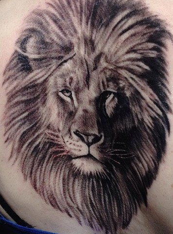 Black and Grey Lion Tattoo