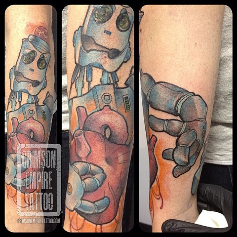 Robot and heart on forearm by Chad Clothier