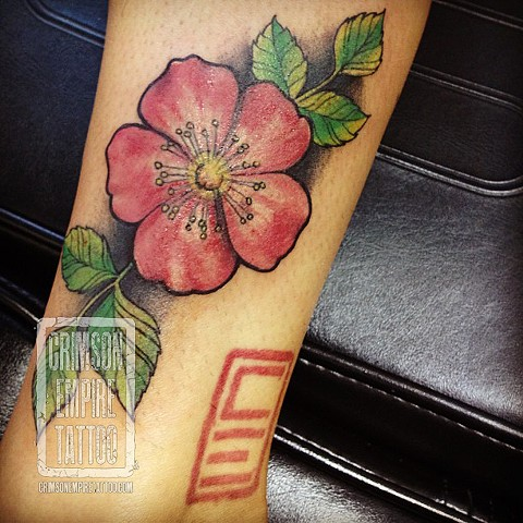 Alberta rose on forearm by Chad Clothier