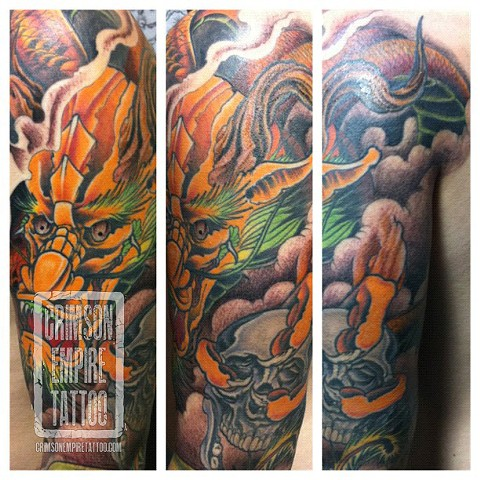 Dragon sleeve on bicep by Jared Phair