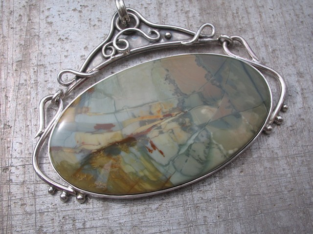 A large jasper in a hinged sterling setting...