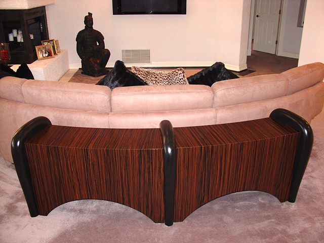 Curved sofa back table