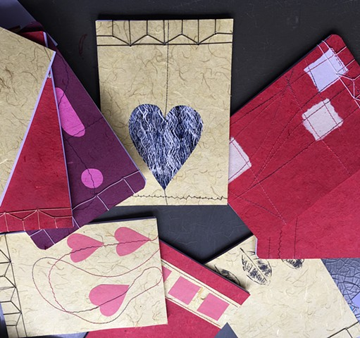 Note pads. Hemp leaf binding with hand stitched/decorated covers.
