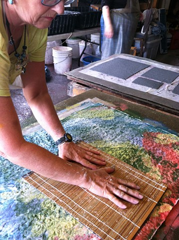 Artist Dorothy Graden painting with cotton rag pulp