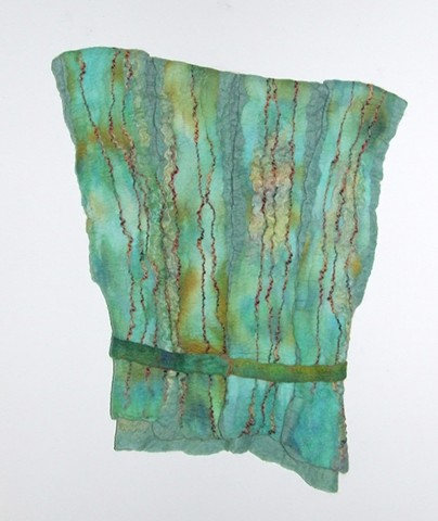 A handmade felt wall piece made of dyed, unspun wool and  yarns, by Sharron Parker.  Inspired by Roman glass and tunics.