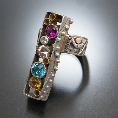 Rectangle ring with blue, pink, purple, yellow gemstones in silver and 14 karat gold