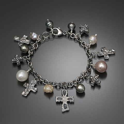 Wax-carved and cast crosses in sterling silver on sterling silver chain with Tahitian and freshwater pearls