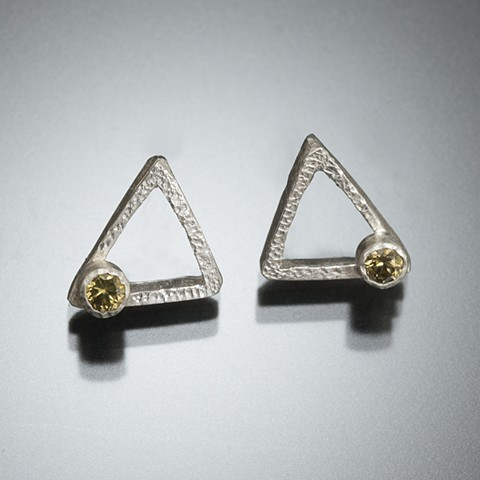 Triangle stud earrings with yellow stones