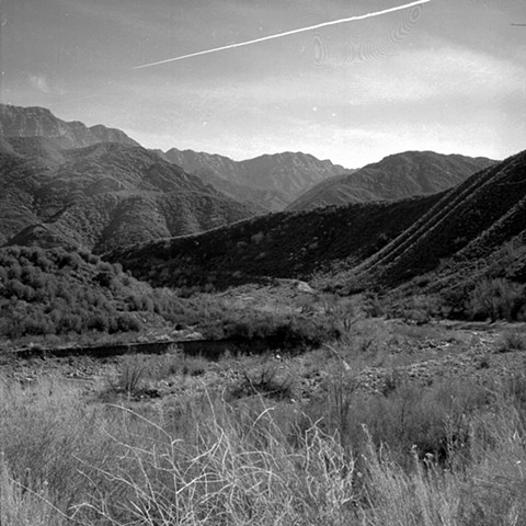 Contrail over Sespe Creek at Ten Sycamore Flat