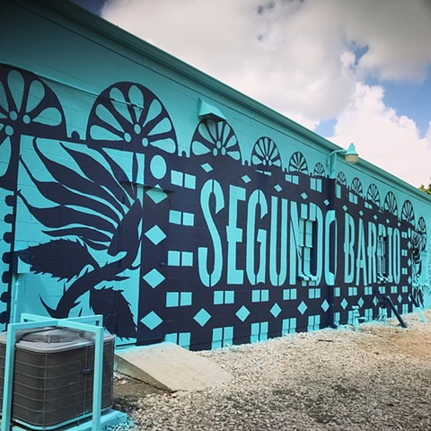 Artist Angel Quesada created it in the East End at Morales Funeral Home denoting the Segundo Barrio or second ward in Houston, Texas.
