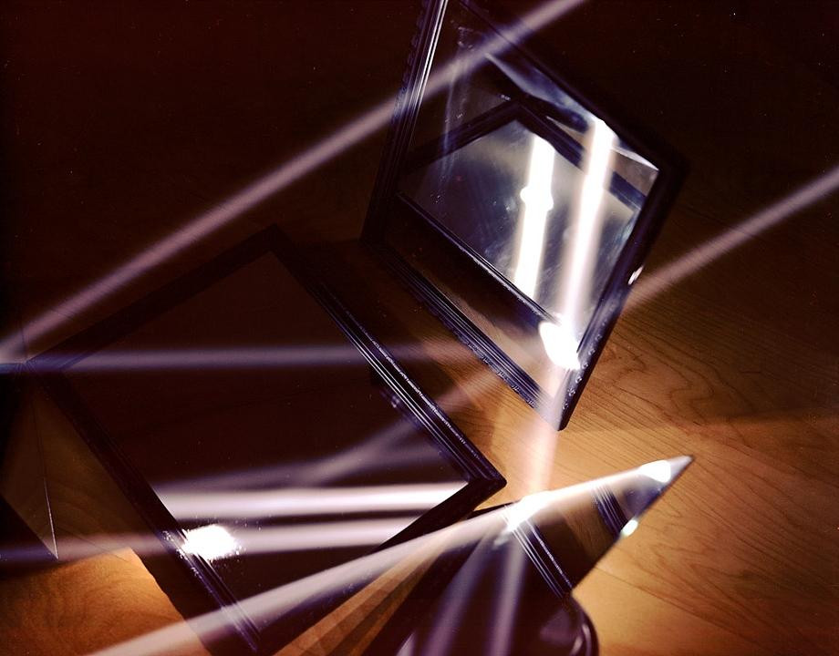 Light reflecting off three mirrors