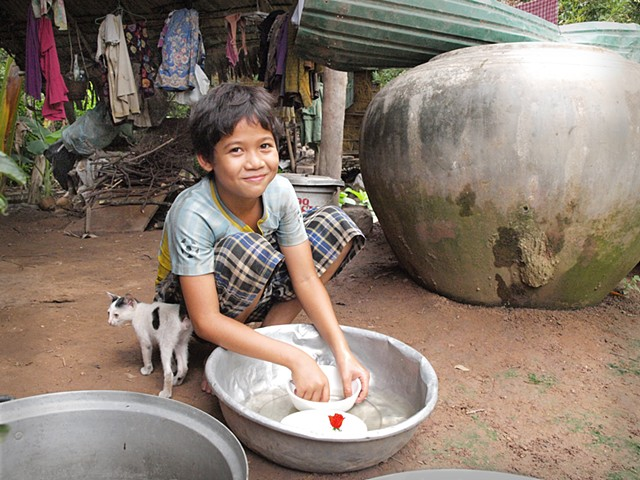 Khmer boy washing dishes