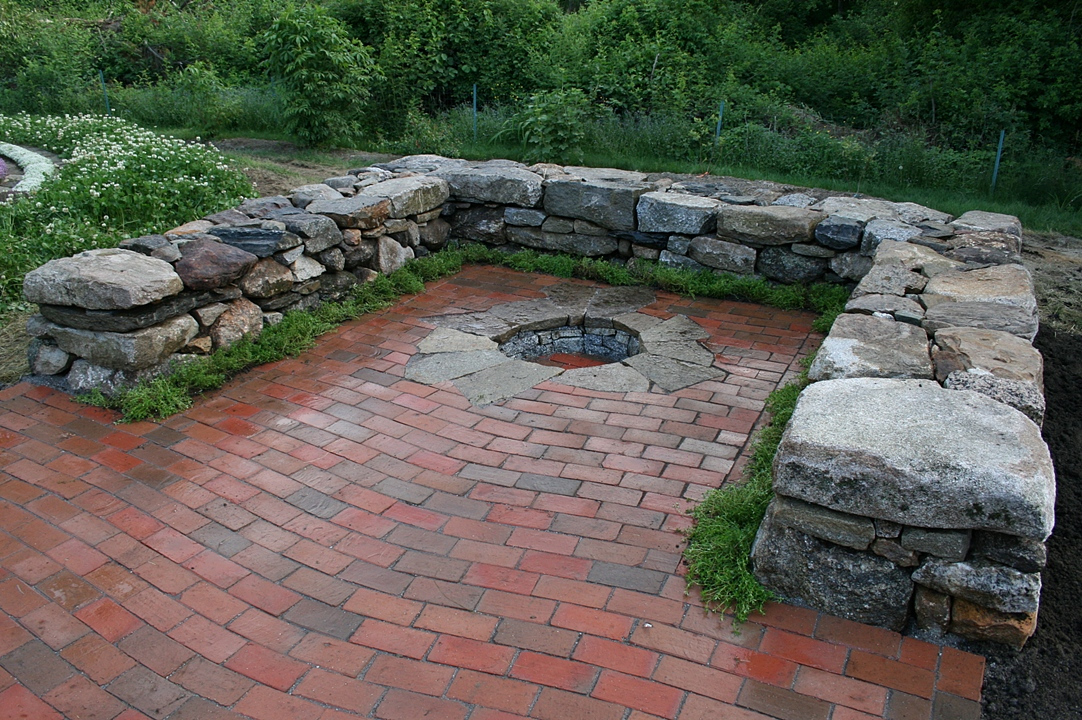 Wavy Lay Brick Patio With Inset Fire Pit And Sitting Walls