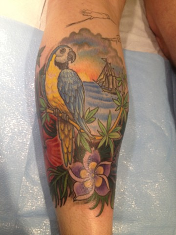 parrot, tropical, flowers, plumeria, hibiscus, ship, ocean, Provincetown tattoo, Cape Cod tattoo, Ptown tattoo, truro tattoo, wellfleet tattoo, custom tattoo, coastline tattoo