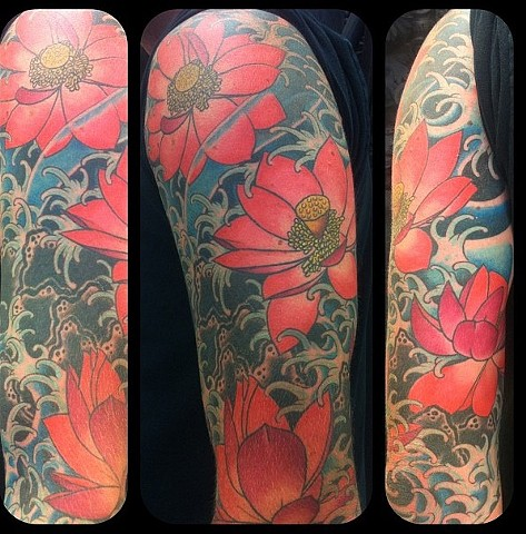 Eric Eaton - lotus flowers w/ water tattoo, Provincetown tattoo, Cape Cod tattoo, Ptown tattoo, truro tattoo, wellfleet tattoo, custom tattoo, coastline tattoo