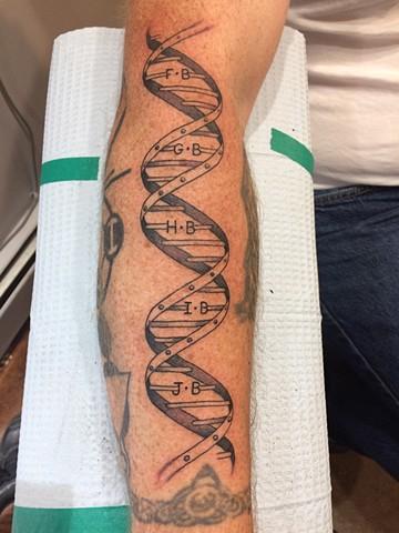 dna, initials, lettering, double helix, medical, gene, Provincetown tattoo, Cape Cod tattoo, Ptown tattoo, truro, wellfleet, custom tattoo, coastline tattoo