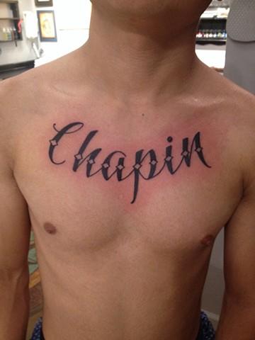 Chapin, Lettering Tattoo, script tattoo, chest tattoo, Provincetown tattoo, Cape Cod tattoo, Ptown tattoo, truro, wellfleet, custom tattoo, coastline tattoo