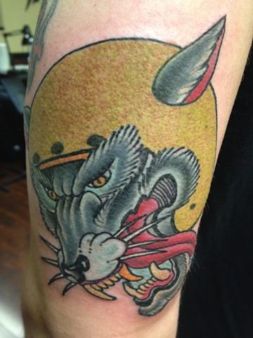 Dave Steele - wolf wearing a motorcycle helmet, Provincetown tattoo, Cape Cod tattoo, Ptown tattoo, truro tattoo, wellfleet tattoo, custom tattoo, coastline tattoo