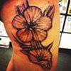 Daniel Emery Jr. - flowers tattoo