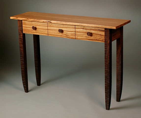 Three drawer custom hall table with carved walnut legs handmade by Kyle Dallman