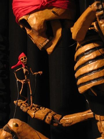 Skeleton Body Puppet holding little Skeleton Rod Puppet