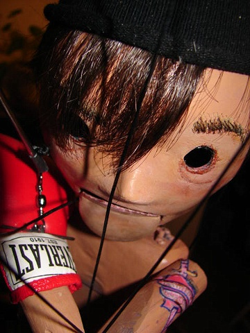 Boxer Marionette with tattoo