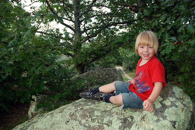 boy on large rock