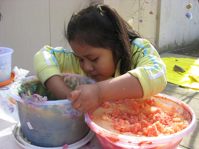 A girl digging for ghee