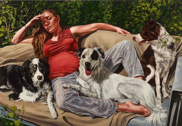 Portrait of woman and dogs on couch