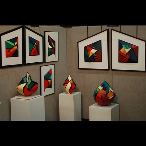 Partial booth photo of work by Terry Habeger.  Pieces are fired clay, handpainted with acrylics.