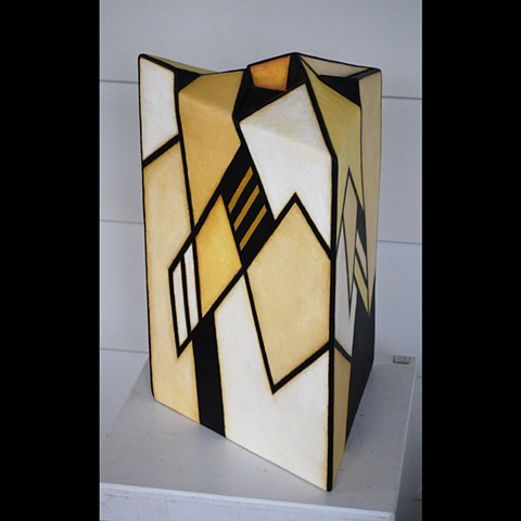 Triangular clay slab sculplture with 3D top, handpainted with acrylics.