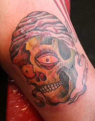 Skull on inside arm.