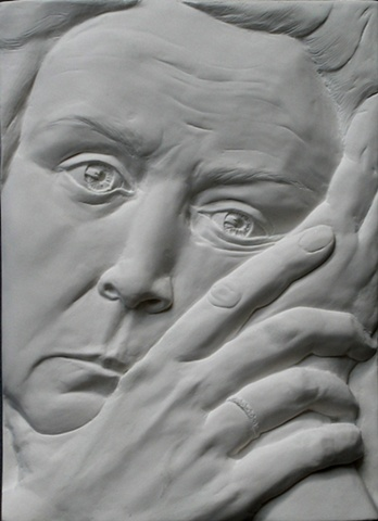 Relief sculpture: Self Portrait in a Time of Grief, by sculptor Rivkah Walton