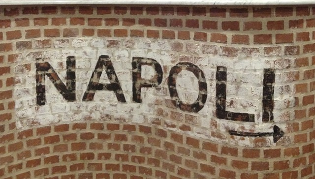 "Hand painted ""Napoli"" on brick"