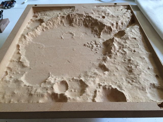 Spirit Crater Moon. This is a  small study for larger sculpture using mushroom mycelium as material. Using topographical data of the surface of Mars. Tharis region is area of formerly active volcanos.