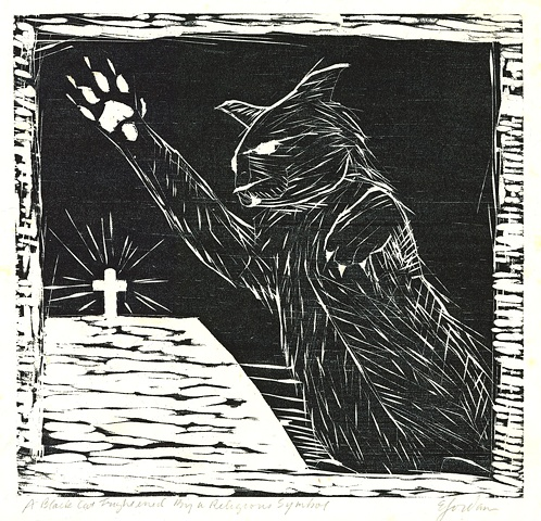 A black cat frightened by a religious symbol