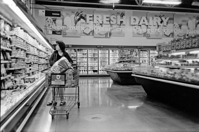 Maggie shops for her husband and family.  She is not partaking in anything in the cart.