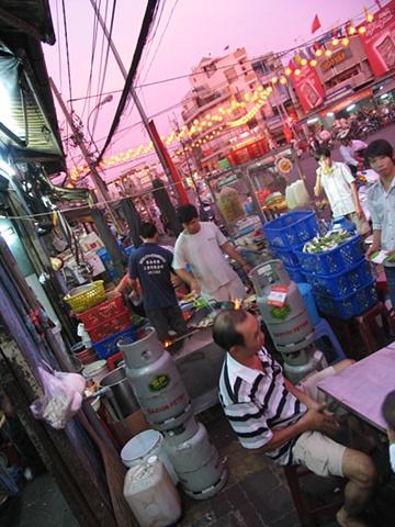 Dinner at a street kiosk, District 10, Ho Chi Minh City.