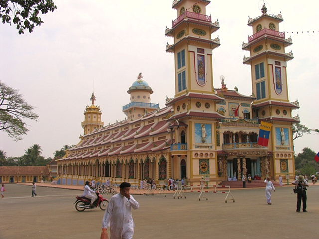 The outside of the Cao Dai Temple.  Founded in 1926, the Cao Dai is a mix of Buddhism, Catholocism, Taoism, Confucianism and Hindu.  Thier saints include Napolean Bonaparte and Victor Hugo.