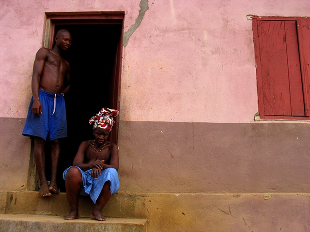 A grandmother and son outside there home, built for war wounded, in Freetown, Sierra Leone