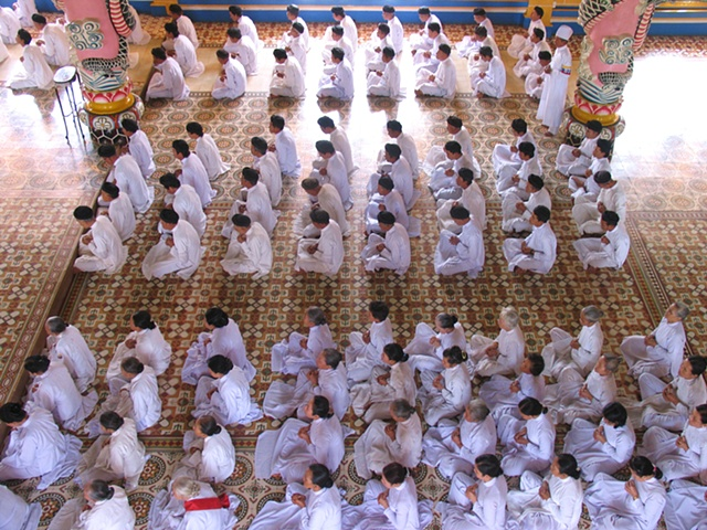 The Cao Dai, a religious sect based in Thay Ninh province, during a daily ceremony.