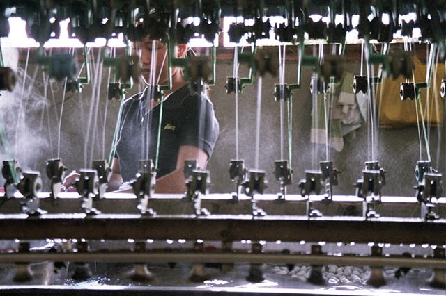 A woman makes silk thread in Dalat.